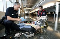 medics work on patient at the airport